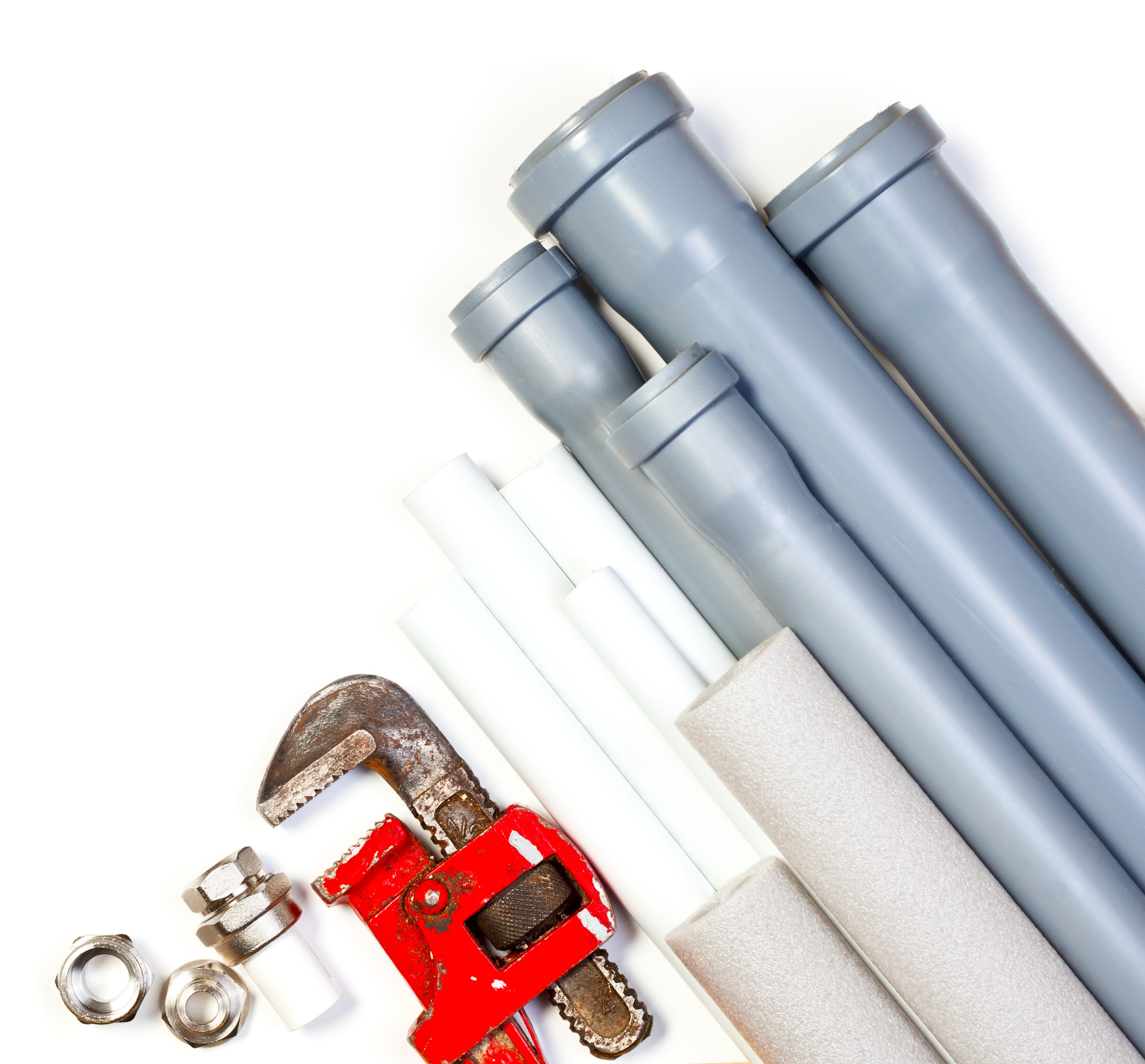 Plumbing pipes and wrench