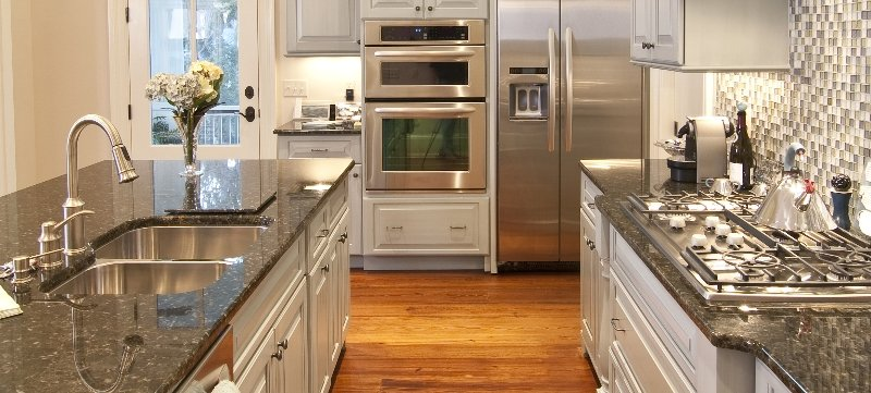 Kitchen with granite counter top and chrome appliances