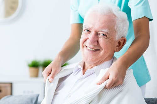 Smiling elderly man having professional home care in Hernando