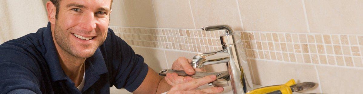 smiling plumber trade edge plumbers