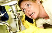 A woman in need of emergency plumbing services in Melbourne