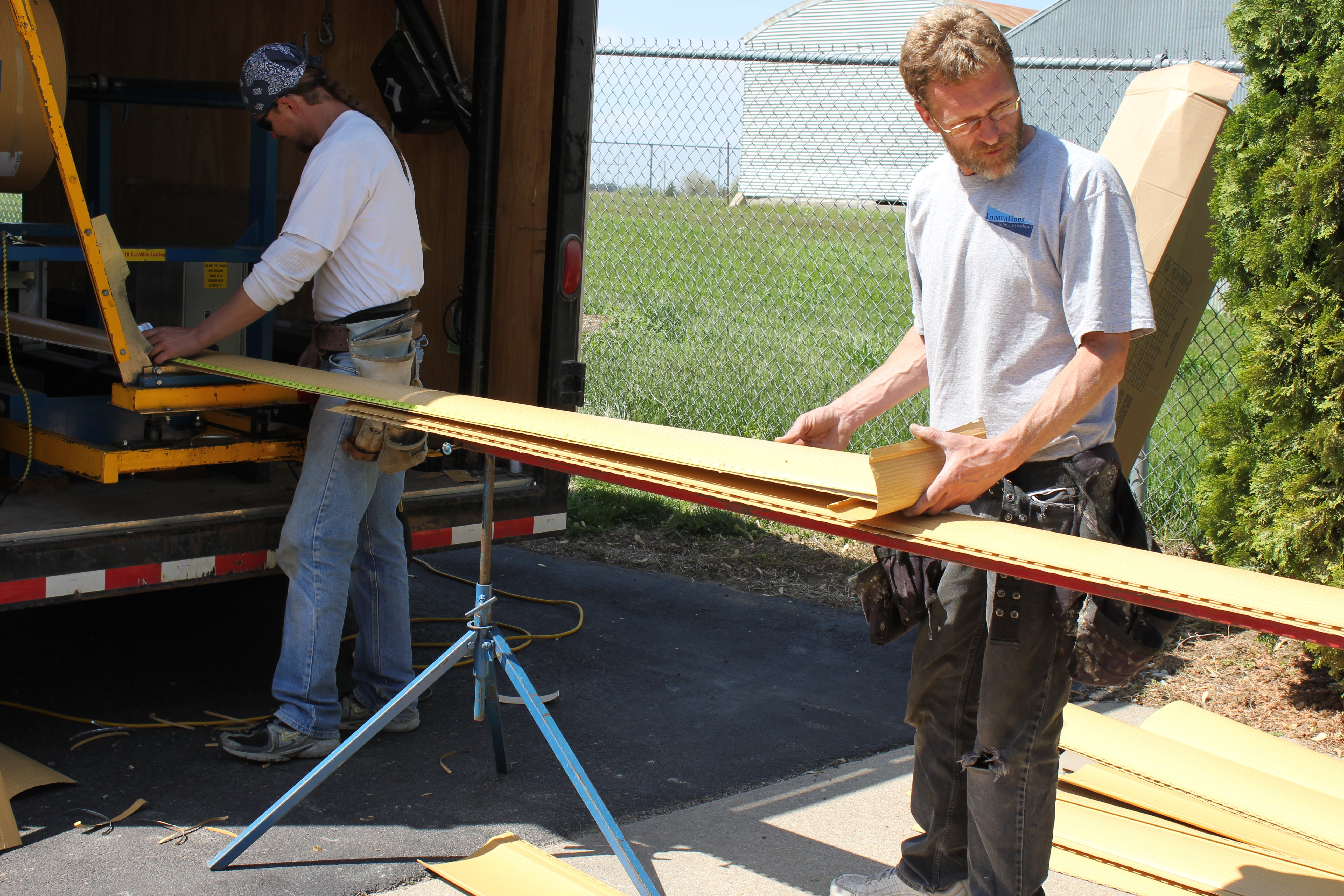 Boe working on a seamless steel log siding job