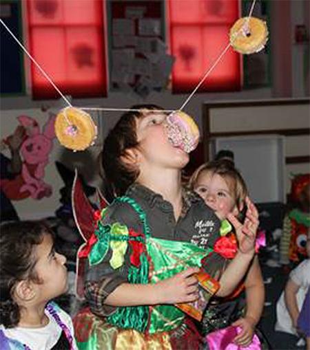 Child biting and donut
