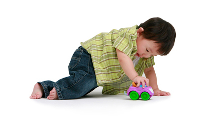 child playing with a car