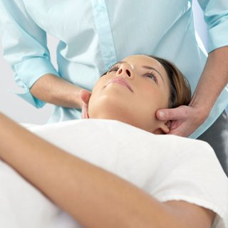 woman getting a chiropractic treatment