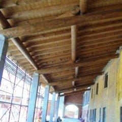 portico in tondo tornito, struttura in legno, tetti in legno val trompia