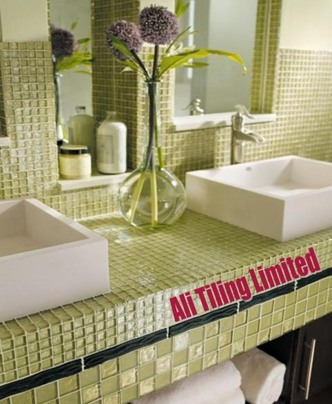 Expert installing bathroom tiles