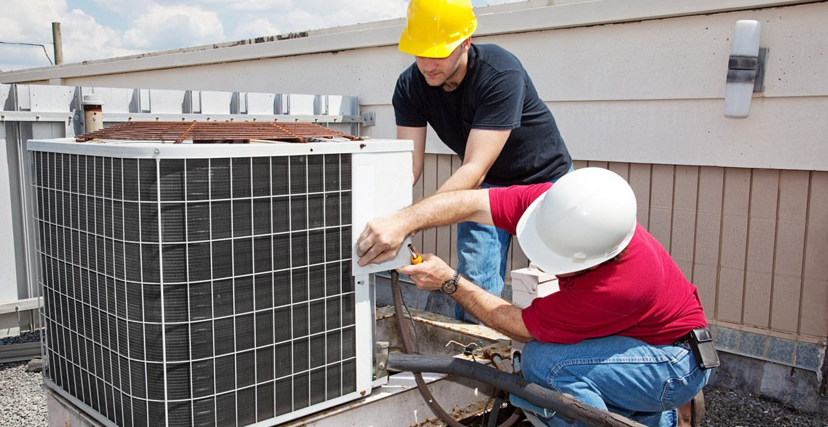 HVAC technician doing HVAC maintenance and repair service in Honolulu, HI