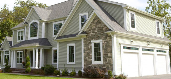 vinyl siding house with rock and with trim