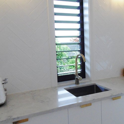 Installed white color kitchen  work top