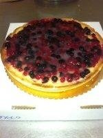 custard flan with fruits of the forest