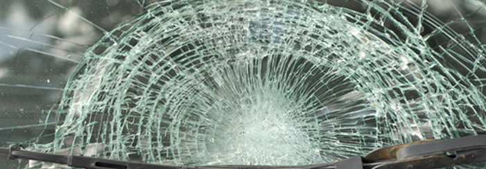 smashed car windscreen with wiper in front