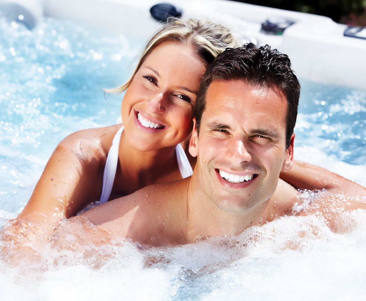 Couple using pool and spa supplies in Robertsdale, AL