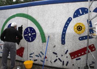 restauro di mosaico e vetro