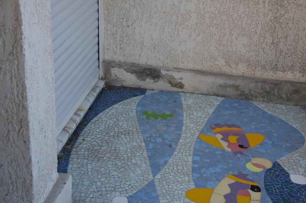 Restauro mosaico pavimentale Ugo NespoloRestauro mosaico pavimentale Ugo Nespolo