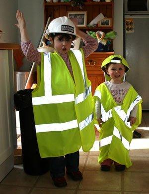 Children in construction uniforms