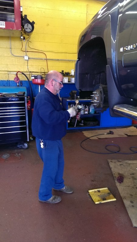View of the professional repairing the auto parts in Meriden, CT