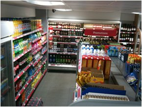 The inside of the Londis mini market at Sudbury Services showing refrigerated displays