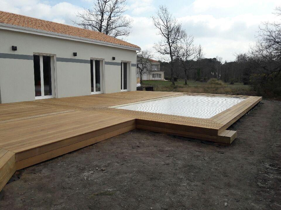 E2so concept r alisation d 39 une terrasse en pourtour de for Que mettre autour d une piscine