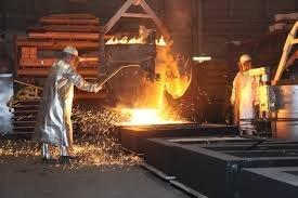 australian foundry institute two men working near the fire