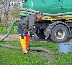 Engineer emptying drainage tanks