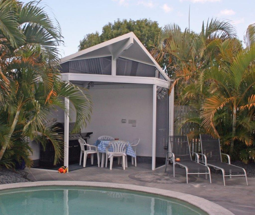 pool with roofing shelter next to it