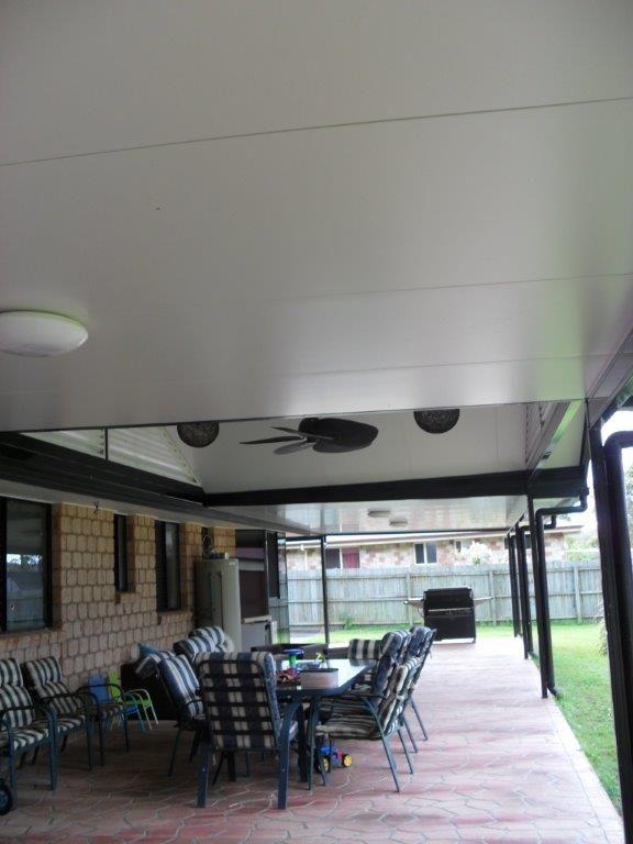 ceiling fan over a backyard patio