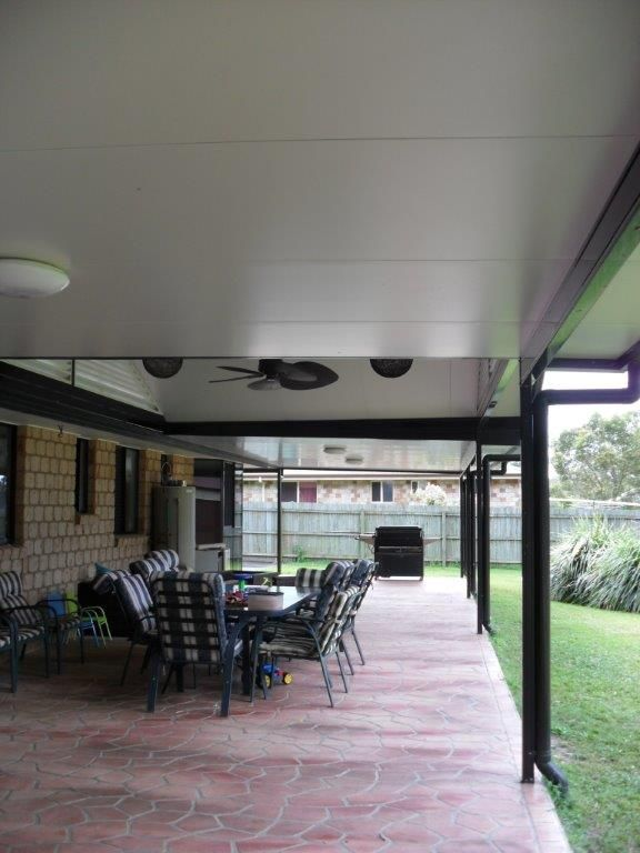 clean roof over backyard patio
