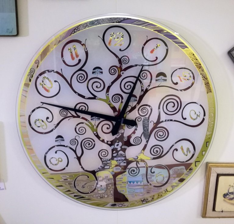 Orologio tondo in vetro, motivi floreali