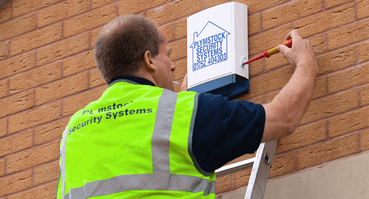 man installing a security system