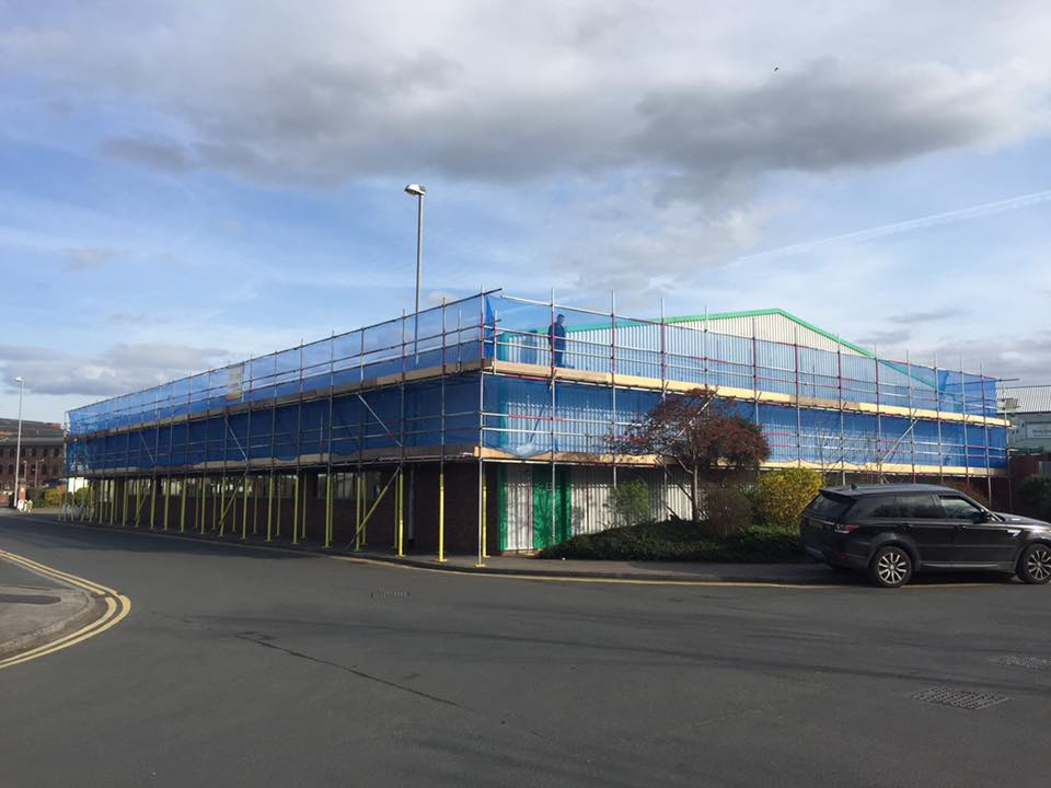 scaffolding around a commercial warehouse