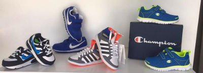 delle scarpe Nike Champions e Adidas da bambino