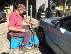 Man providing wheel alignment on the Central Coast