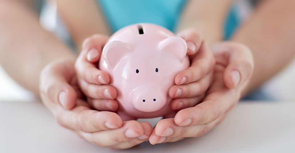 Caring the girl with piggy bank in hand