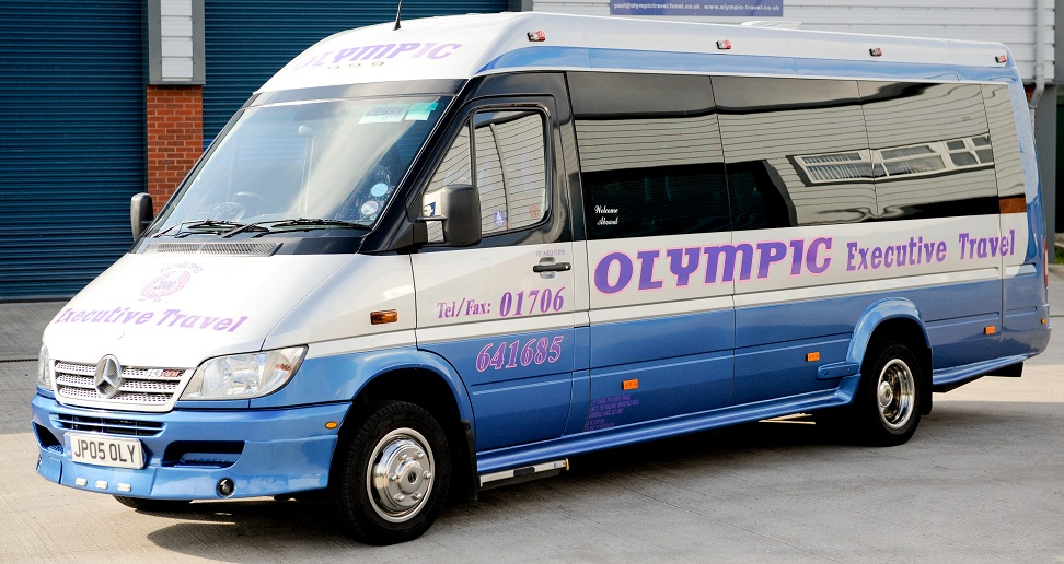 An Olympic Travel minibus