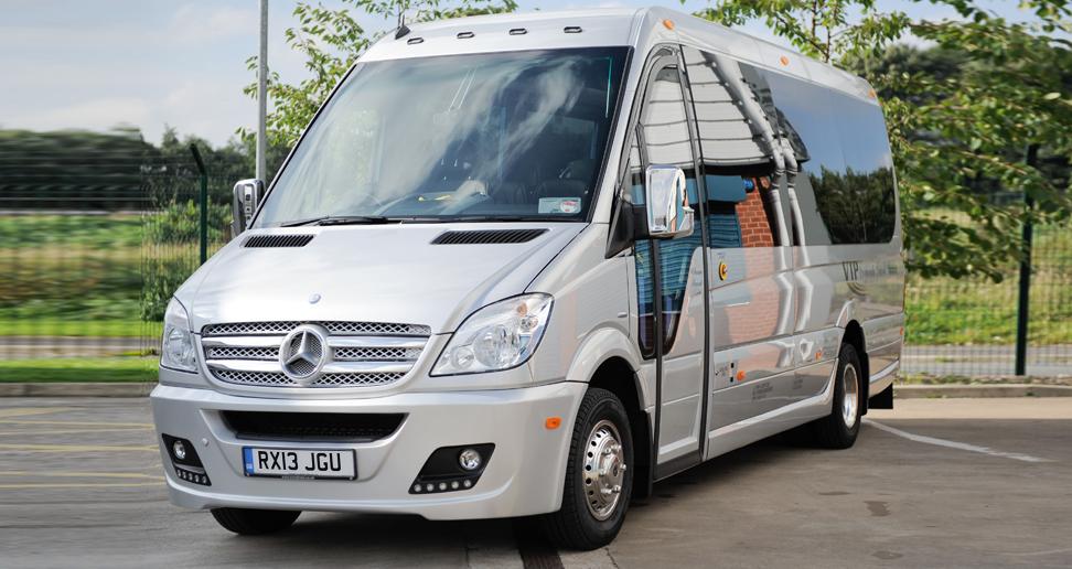 An Olympic Travel minibus