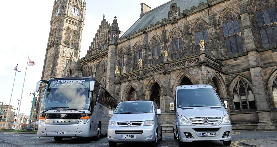 The Olympic Travel fleet - car, minibus and coach - outside Rochdale town hall