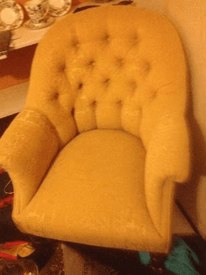 button back yellow upholstered armchair