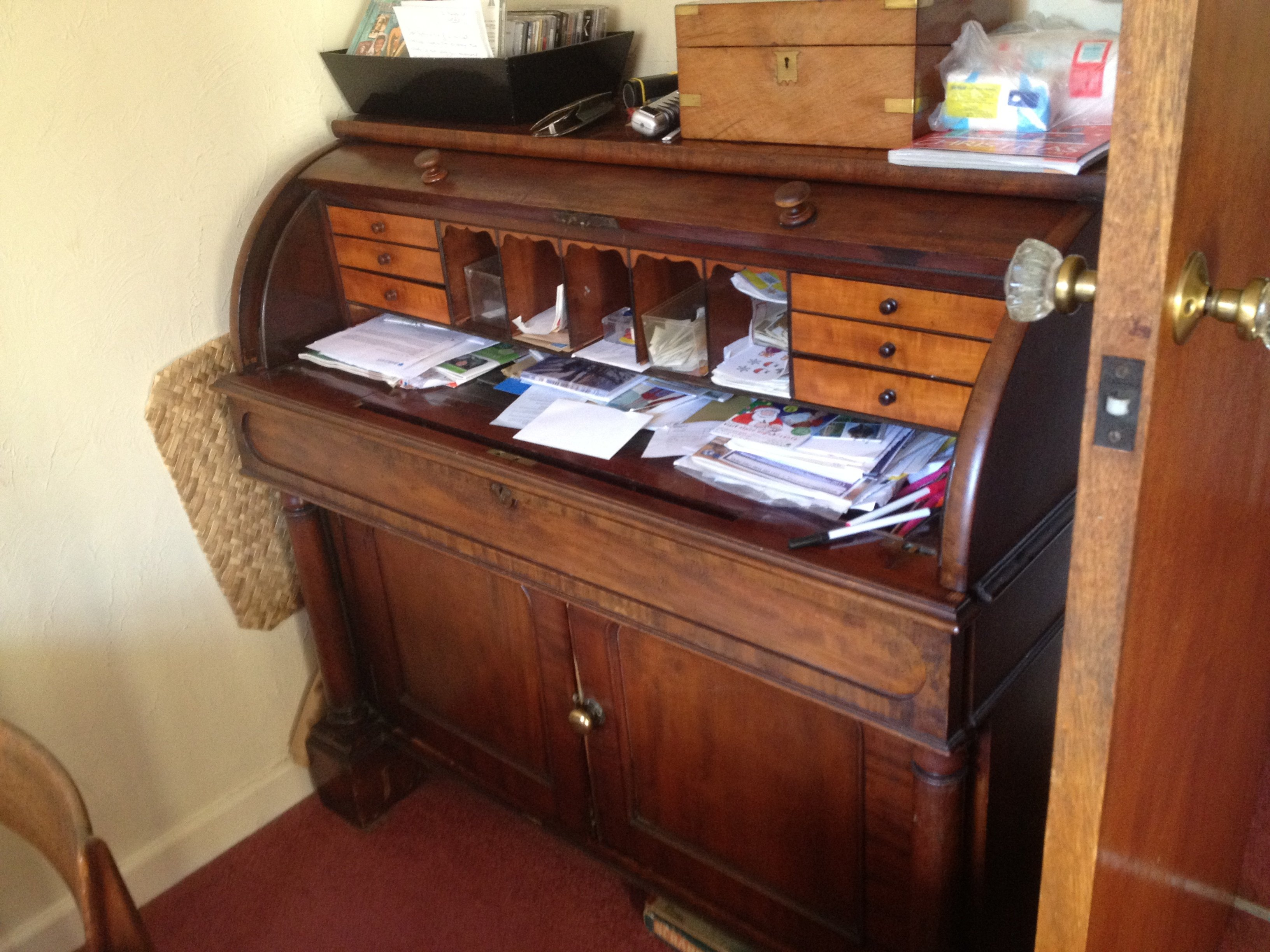 roll top desk with paperwork visible