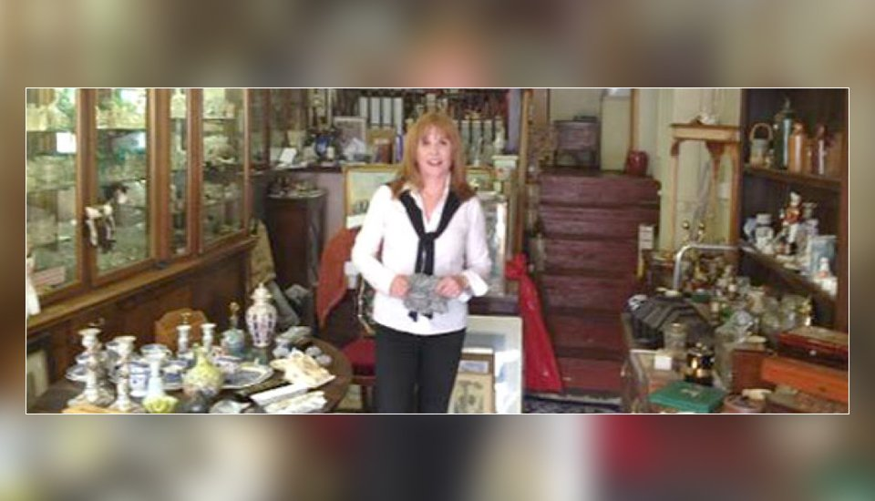 woman in antique shop looking to camera