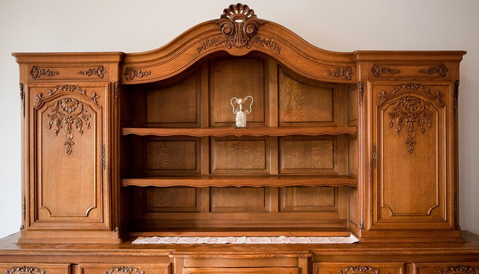 welsh dresser with carved additions on doors
