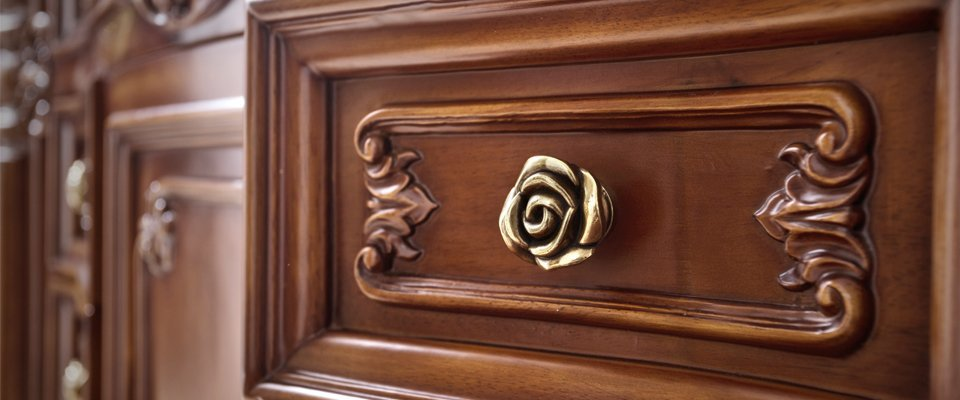 detail of carving on drawer of antique sideboard