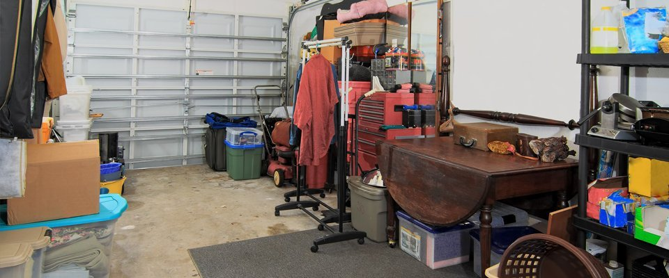 a garage interior full of clutter and tools