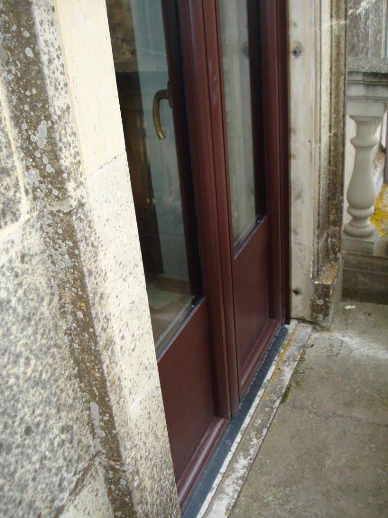 posa in opera porta finestra alluminio legno