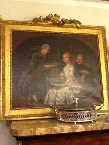 un dipinto di una donna e due uomini con una cornice