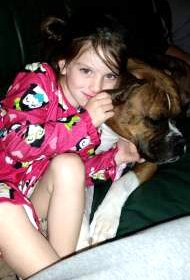 Boxer dog with young child
