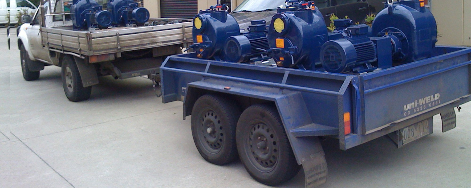 Pump being transported on machine