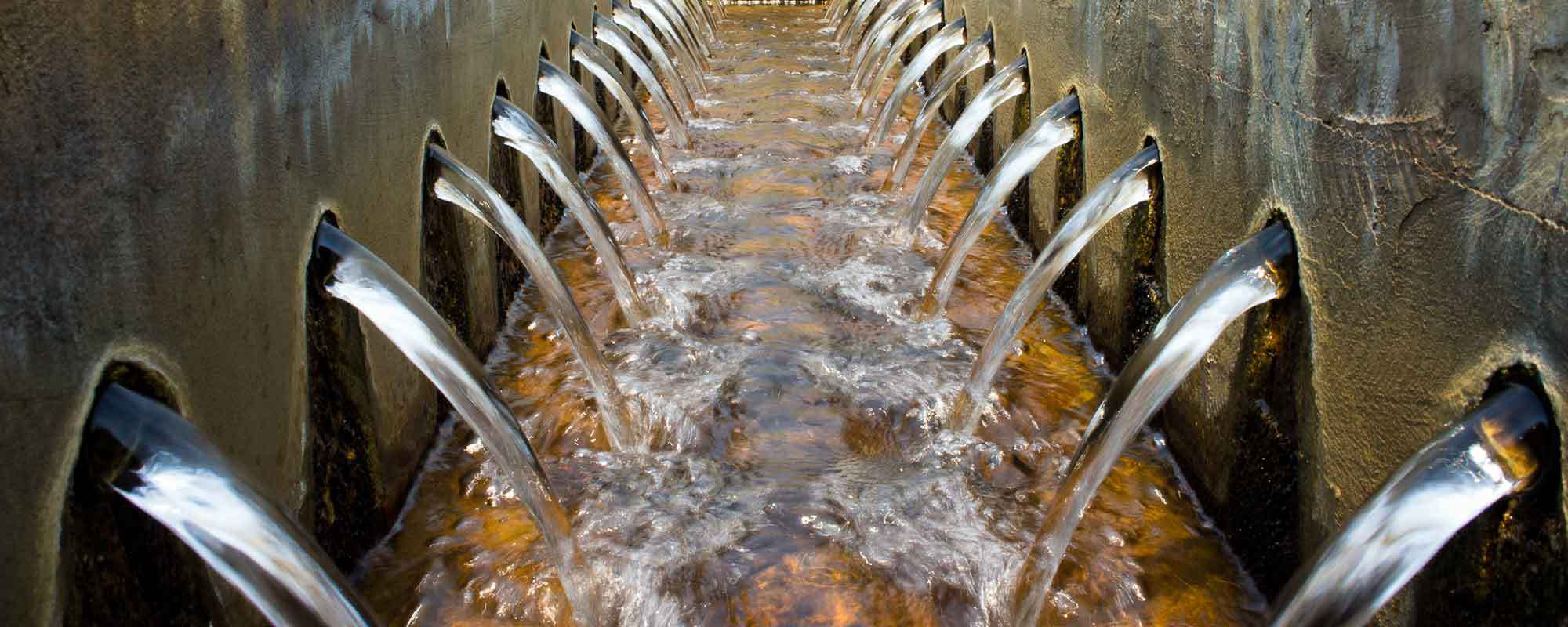 Water being pumped by heavy pumps