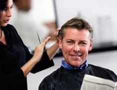 A customer getting his hair cut at our beauty salon in Foley