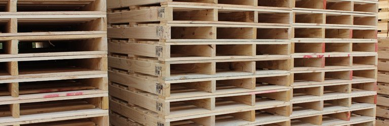 palletco sa racks of wooden pallets